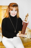 Posting with trophy, 1995